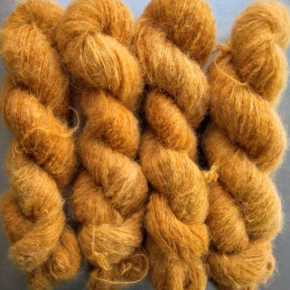 Anemone - Light orange with a yellow undertone suri alpaca and silk luxury heavy laceweight yarn. Hand-dyed by Triskelion Yarn