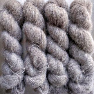 Chesil - Pale warm grey suri alpaca and silk luxury heavy laceweight yarn. Hand-dyed by Triskelion Yarn