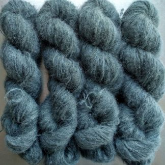 Endless Forms - A mid grey with a sea green-blue undertone suri alpaca and silk luxury heavy laceweight yarn. Hand-dyed by Triskelion Yarn