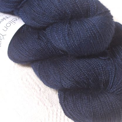 Dark navy Bluefaced Leicester (BFL) / Gotland / Wensleydale 4-ply (fingering) weight high-twist sock yarn. Hand-dyed by Triskelion Yarn
