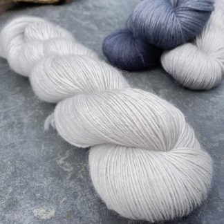 Blue-eyed Barbarian – Bright, palest of greys that could be treated as a white baby alpaca 4-ply/fingering/sock yarn. Hand-dyed by Triskelion Yarn