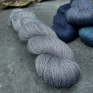 Caerthan's Grey – Light cadet grey with a delicate electric blue undertone baby alpaca 4-ply/fingering/sock yarn. Hand-dyed by Triskelion Yarn