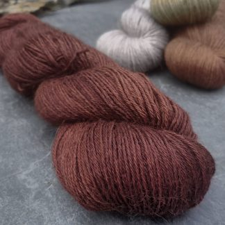 Epona - Dark, rich red chestnut brown baby alpaca 4-ply/fingering/sock yarn. Hand-dyed by Triskelion Yarn