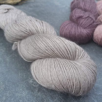 Pascal – Very light warm grey baby alpaca 4-ply/fingering/sock yarn. Hand-dyed by Triskelion Yarn