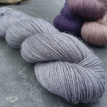 Sea Holly – Light grey with a soft violet undertone baby alpaca 4-ply/fingering/sock yarn. Hand-dyed by Triskelion Yarn