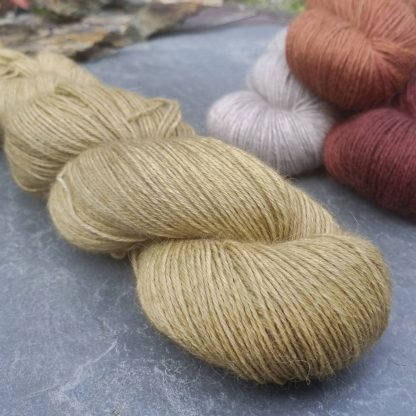 Shore - Light, sandy brown baby alpaca 4-ply/fingering/sock yarn. Hand-dyed by Triskelion Yarn