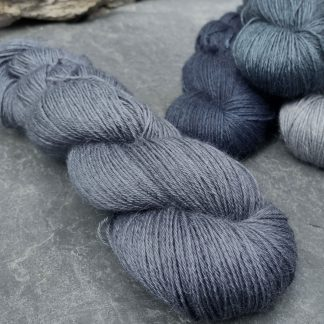 Stormcloud – Dark grey with a blue-violet undertone baby alpaca 4-ply/fingering/sock yarn. Hand-dyed by Triskelion Yarn