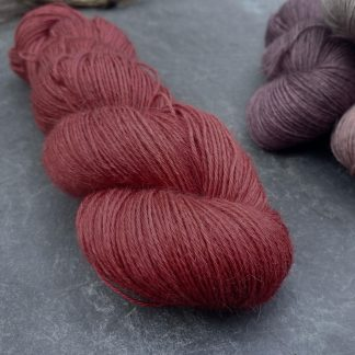 Yewberry – Soft, complex warm red with brick tones baby alpaca 4-ply/fingering/sock yarn. Hand-dyed by Triskelion Yarn