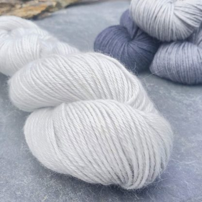 Blue-eyed Barbarian – Bright, palest of greys that could be treated as a white baby alpaca double knit (DK) yarn. Hand-dyed by Triskelion Yarn