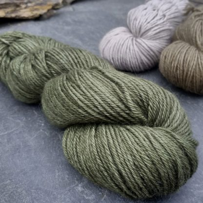 Bodhi – Mid-toned grey-green with a slight olive undertone baby alpaca double knit (DK) yarn. Hand-dyed by Triskelion Yarn