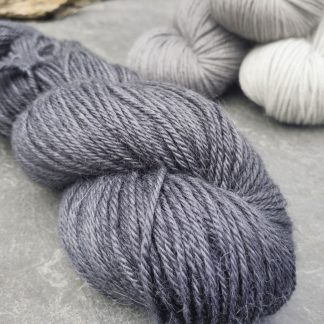 Charcoal - Dark grey-black with a cool tone baby alpaca double knit (DK) yarn. Hand-dyed by Triskelion Yarn