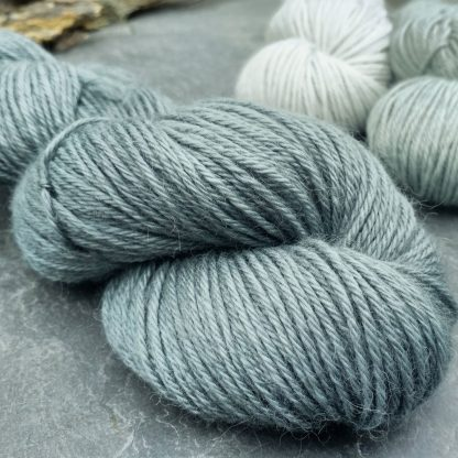 Endless Forms - Mid-toned grey with an aqua-green undertone baby alpaca double knit (DK) yarn. Hand-dyed by Triskelion Yarn