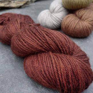 Epona - Dark, rich red chestnut brown baby alpaca double knit (DK) yarn. Hand-dyed by Triskelion Yarn