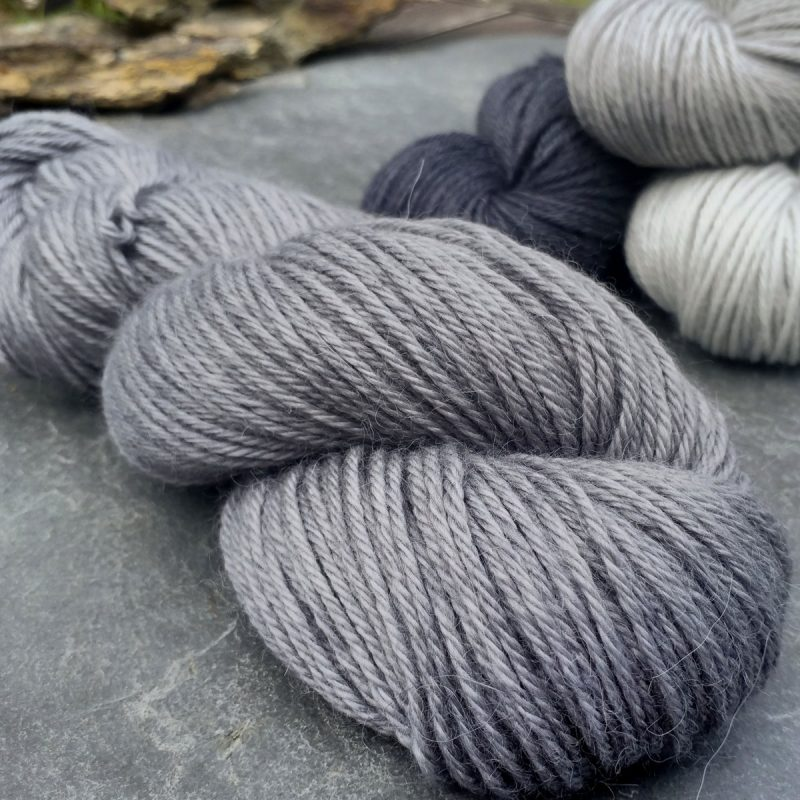 Graphite - Cool, mid-toned grey baby alpaca double knit (DK) yarn. Hand-dyed by Triskelion Yarn