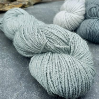 Rain-washed – Light grey with a dusty aqua undertone baby alpaca double knit (DK) yarn. Hand-dyed by Triskelion Yarn