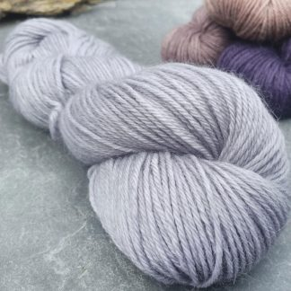 Sea Holly – Light grey with a soft violet undertone baby alpaca double knit (DK) yarn. Hand-dyed by Triskelion Yarn