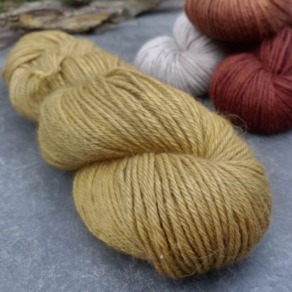 Shore - Light, sandy brown baby alpaca double knit (DK) yarn. Hand-dyed by Triskelion Yarn