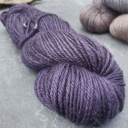 baby alpaca double knit (DK) yarn. Hand-dyed by Triskelion YarnSloe - Complex, dark violet-purple with an electric blue undertone