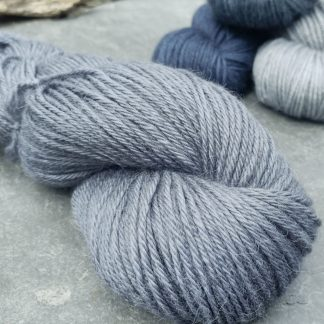 Stormcloud – Dark grey with a blue-violet undertone baby alpaca double knit (DK) yarn. Hand-dyed by Triskelion Yarn
