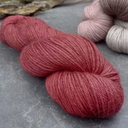 Yewberry – Soft, complex warm red with brick tones baby alpaca double knit (DK) yarn. Hand-dyed by Triskelion Yarn