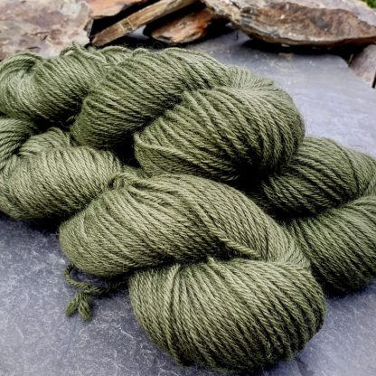 Bodhi – Mid-toned grey-green with a slight olive undertone Bluefaced Leicester (BFL) / Gotland aran weight yarn. Hand-dyed by Triskelion Yarn
