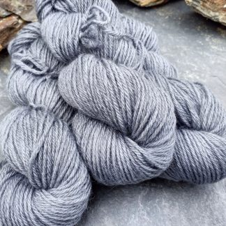 Caerthan's Grey – Light cadet grey with a delicate electric blue undertone Bluefaced Leicester (BFL) / Gotland aran weight yarn. Hand-dyed by Triskelion Yarn