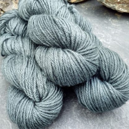 Endless Forms - Mid-toned grey with an aqua-green undertone Bluefaced Leicester (BFL) / Gotland aran weight yarn. Hand-dyed by Triskelion Yarn