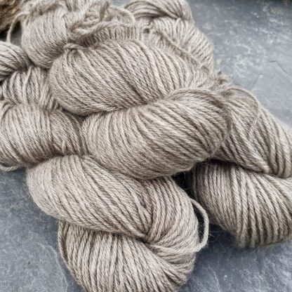Pascal – Very light warm grey Bluefaced Leicester (BFL) / Gotland aran weight yarn. Hand-dyed by Triskelion Yarn