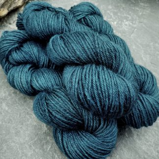 Petrol Blue - Mid- to dark toned greenish blue Bluefaced Leicester (BFL) / Gotland aran weight yarn. Hand-dyed by Triskelion Yarn