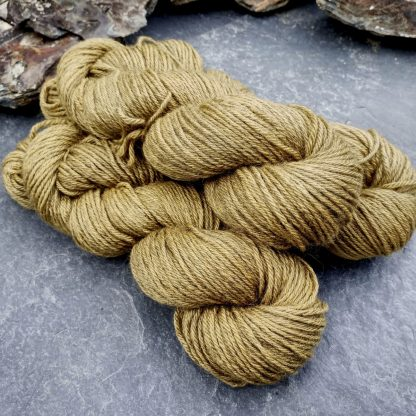 Shore - Light, sandy brown Bluefaced Leicester (BFL) / Gotland aran weight yarn. Hand-dyed by Triskelion Yarn