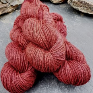 Yewberry – Soft, complex warm red with brick tones Bluefaced Leicester (BFL) / Gotland aran weight yarn. Hand-dyed by Triskelion Yarn