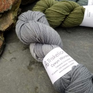 Caerthan's Grey – Light cadet grey with a delicate electric blue undertone Corriedale heavy DK/worsted weight yarn. Hand-dyed by Triskelion Studio.
