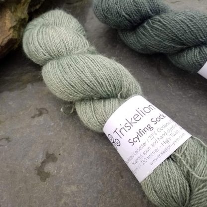 Rain-washed – Light grey with a dusty aqua undertone Bluefaced Leicester (BFL) / Gotland / Wensleydale 4-ply (fingering) weight high-twist sock yarn. Hand-dyed by Triskelion Yarn