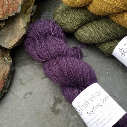Sloe - Complex, dark violet-purple with an electric blue undertone Bluefaced Leicester (BFL) / Gotland / Wensleydale 4-ply (fingering) weight high-twist sock yarn. Hand-dyed by Triskelion Yarn