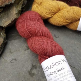 Yewberry – Soft, complex warm red with brick tones Bluefaced Leicester (BFL) / Gotland / Wensleydale 4-ply (fingering) weight high-twist sock yarn. Hand-dyed by Triskelion Yarn
