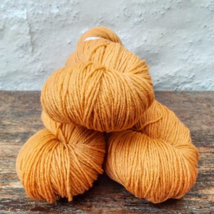 Anemone - Apricot orange 4-ply/fingering Peruvian Highland wool sock yarn. Hand-dyed by Triskelion Yarn.