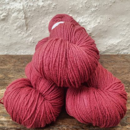 Karenia - Mid- to dark scarlet red 4-ply/fingering Peruvian Highland wool sock yarn. Hand-dyed by Triskelion Yarn.