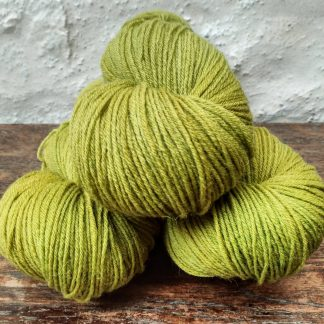 Kelp - Mid-toned chartreuse green 4-ply/fingering Peruvian Highland wool sock yarn. Hand-dyed by Triskelion Yarn.