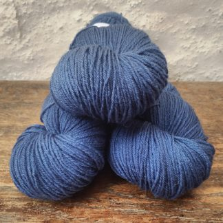 Leviathan - Mid- to dark azure blue 4-ply/fingering Peruvian Highland wool sock yarn. Hand-dyed by Triskelion Yarn.