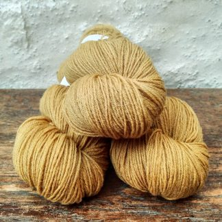 Sandbar - Sandy yellow taupe 4-ply/fingering Peruvian Highland wool sock yarn. Hand-dyed by Triskelion Yarn.