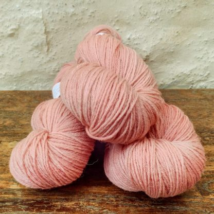 Shell - Light scarlet pink 4-ply/fingering Peruvian Highland wool sock yarn. Hand-dyed by Triskelion Yarn.