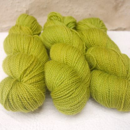 Frea - Light spring green Bluefaced Leicester 4-ply / fingering weight yarn hand-dyed by Triskelion Yarns
