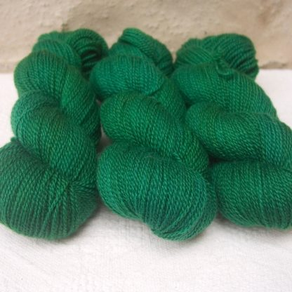 Nemeton - Mid-tone emerald green Bluefaced Leicester 4-ply / fingering weight yarn hand-dyed by Triskelion Yarns