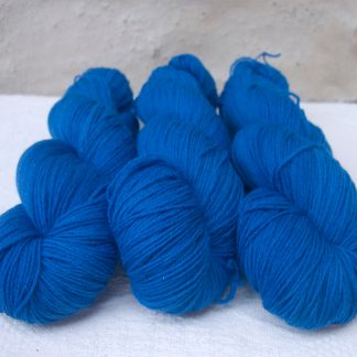 Ælfred - Mid-toned royal blue 4-ply/fingering Peruvian Highland wool sock yarn. Hand-dyed by Triskelion Yarn.