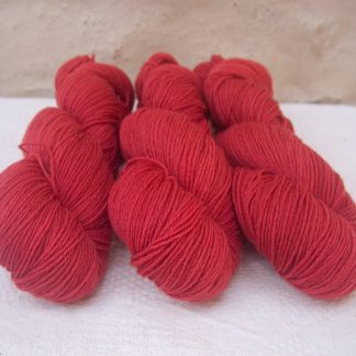 Aldebaran - Brick red 4-ply/fingering Peruvian Highland wool sock yarn. Hand-dyed by Triskelion Yarn.