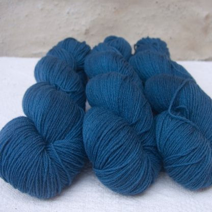 Arawn - Semi-solid to solid deep royal blue 4-ply/fingering Peruvian Highland wool sock yarn. Hand-dyed by Triskelion Yarn.