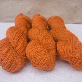 Arcturus - Fresh light to mid orange 4-ply/fingering Peruvian Highland wool sock yarn. Hand-dyed by Triskelion Yarn.