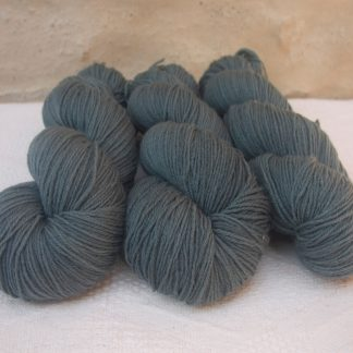 Endless Forms - Mid-toned grey with an aqua-green undertone 4-ply/fingering Peruvian Highland wool sock yarn. Hand-dyed by Triskelion Yarn.