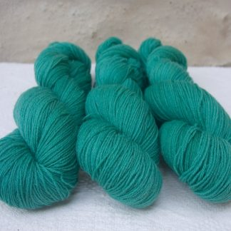 Fionnuala - Light to mid-tone teal green 4-ply/fingering Peruvian Highland wool sock yarn. Hand-dyed by Triskelion Yarn.