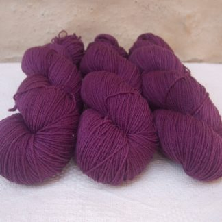 Freo - Semi-solid deep red-violet 4-ply/fingering Peruvian Highland wool sock yarn. Hand-dyed by Triskelion Yarn.